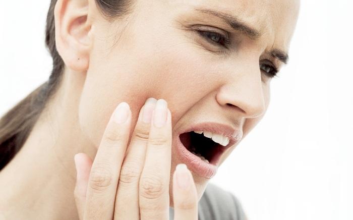 Боль в десне после удаления зуба